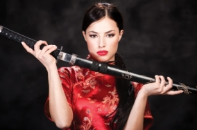 woman in red with sword